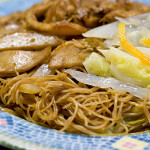 Fried beehoon with fishcake, chicken, and cabbage.
