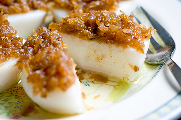 Steamed soft round rice cakes topped with preserved radish
