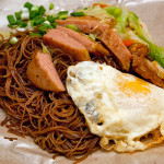 Fried bee hoon with fried egg, luncheon meat, and stir-fried cabbage