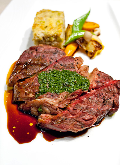 Grilled Basque Wagyu striploin with leek bread pudding & roasted sesame-coriander vegetables.