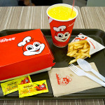Chickenjoy with Spaghetti meal, S$6.60; and add-on Fries, S$1.50.