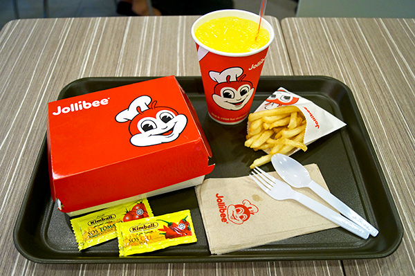 Chickenjoy with Spaghetti meal, S$  6.60; and add-on Fries, S$  1.50.